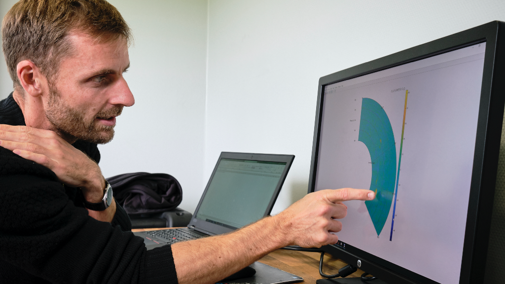 NRS staff member points out FOD on a radar chart